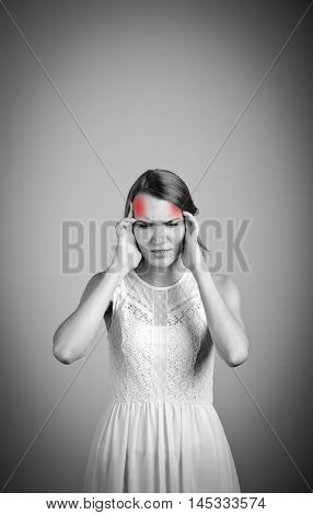 Girl in white suffering from headache. Headache and symptoms concept.