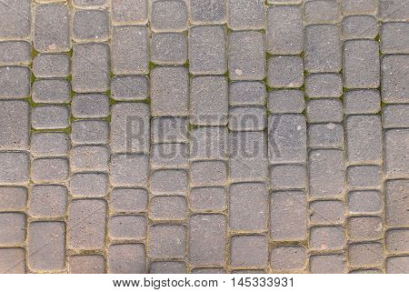 Stone pavement texture. Granite cobblestoned pavement background. Abstract background of old cobblestone