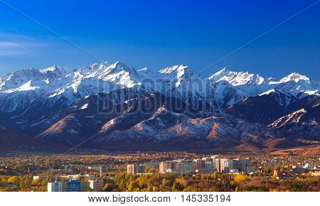 Almaty, Kazakhstan - October 21, 2016. Snow-capped mountains over Almaty in the morning.
