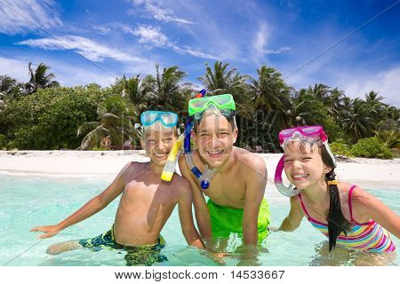 Smiling siblings swimming