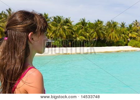 Little girl watching the sea