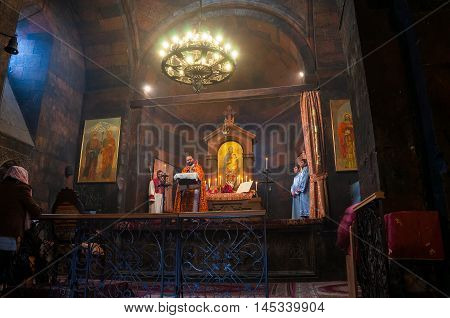 ARARAT, ARMENIA - MARCH 24, 2016: Easter service with armenian catholics inside the Khor-Virap monastery located close to Artashat