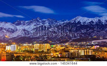 Almaty, Kazakhstan, December 26, 2015. The upper part of Almaty under the full moon light.