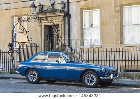 BATH, UK - CIRCA OCTOBER 2011: A blue MGB GT parked in the street.