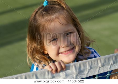 Beautiful girl at tennis court