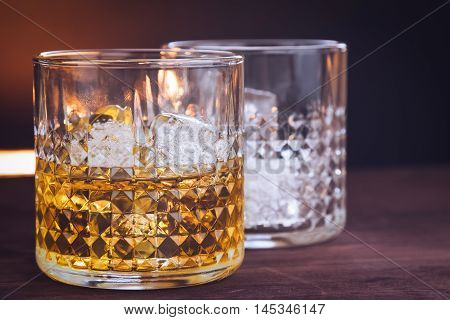 Two Glass Of Whiskey With Ice Cubes On Wood Table, Warm Atmosphere