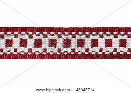 Red and white embroidered ribbon isolated over white