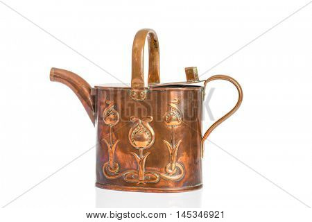 Antique Art Nouveau watering can isolated on a white background