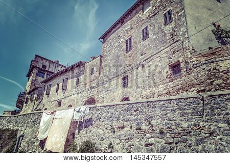 rustic corner in San Gimignano in hdr Italy