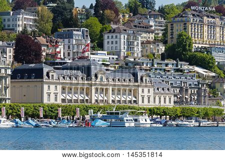 LUCERNE SWITZERLAND - MAY 05 2016: The classical building of The Grand Casino Luzern formerly Kursaal is located on famous lakeside promenade and is facing to lake Lucerne and was built in 1882