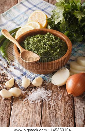 Argentine Chimichurri Sauce And Freshly Prepared Ingredients Close-up. Vertical