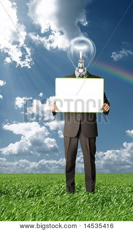 Businessman With Lamp-head Holding Blank Card Outdoors