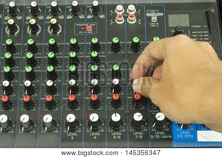 music mixer electronic sound board and male hand