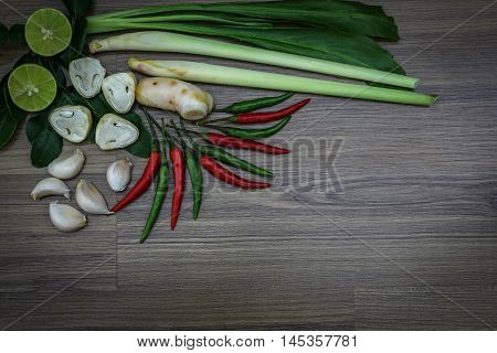 Fresh herbs and spices on wooden background Ingredients of Thai spicy food Ingredients of Tom yum Still life photography with ingredients The art of food photography with the ingredients