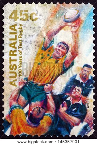 AUSTRALIA - CIRCA 1999: a stamp printed in the Australia shows Catching Ball Test Rugby in Australia Centenary circa 1999