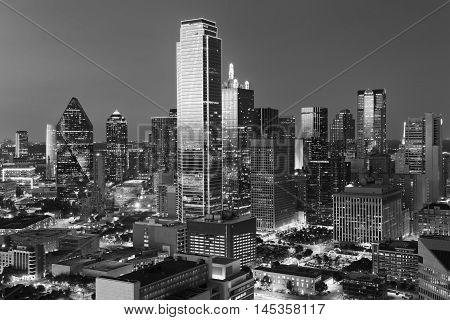 Dallas City Skyline at dusk sunset. Dallas Texas downtown business center. Commercial zone in big city. Dallas City view from Reunion Tower. Black and white tone.