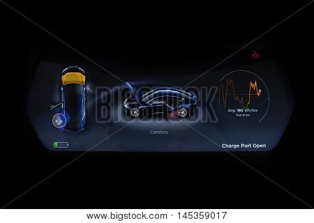 Sofia, Bulgaria - August 29, 2016: Electric Vehicle dashboard panel isolated on a black background. An electric car is an automobile that is propelled by one or more electric motors using electrical energy stored in rechargeable batteries.