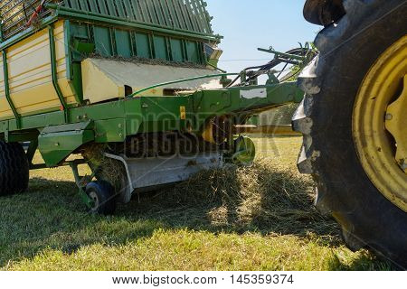 Haymaking with a loading wagons - Closeup fodder