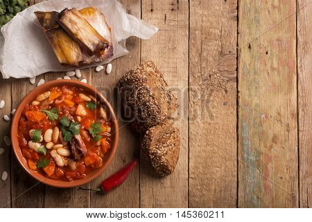 Rustic Kidney Bean Soup with beans and carrot. On the wooden table