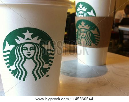 St. Petersburg, Russia - September 1: Two cups with hot coffee on the table at starbucks coffee shop. Starbucks is a fast growing company regularly opening new stores in Russia.