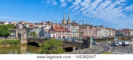 Panorama of Bayonne with bridge Pont du Genie across the Nive river on the front view Aquitaine France