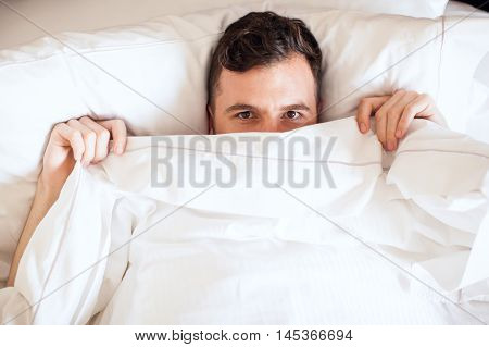 Young Single Man Lying In Bed
