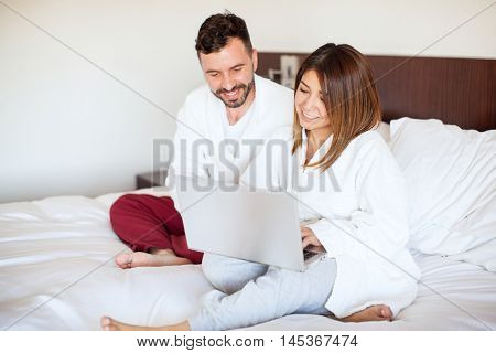 Couple On Vacation Using A Laptop