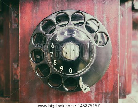 Ancient Vintage Wooden rustic Dial phone closed up.