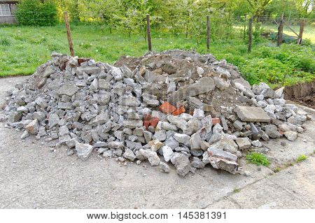 heap of rubble and bricks on the concrete plaza