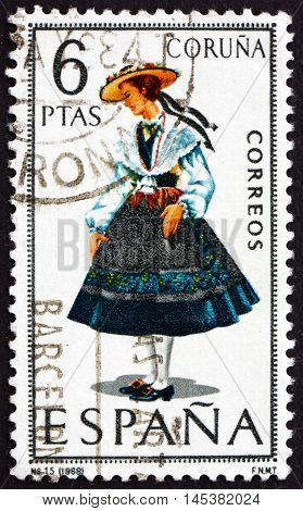 SPAIN - CIRCA 1968: a stamp printed in Spain shows Woman from Coruna Regional Costume circa 1968