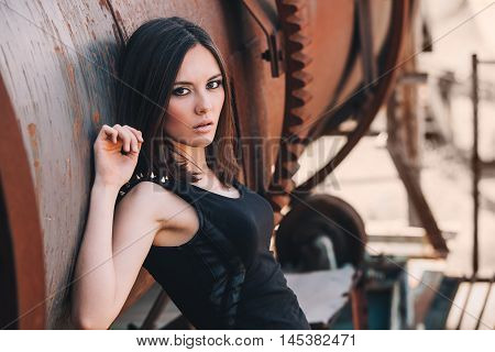 Portrait Of Fashion Model Girl On The Industrial Background.