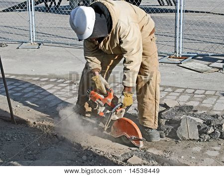 Worker Cutting Pavement