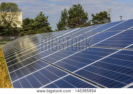 Solar Panel Farm. Corn Fields are Being Converted into Green Energy Areas Using Photovoltaic Cells I