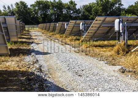 Solar Panel Farm. Corn Fields are Being Converted into Green Energy Areas Using Photovoltaic Cells VII