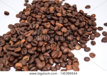 Isolated Scattered Coffee Beans Closeup. Coffee Seeds on White Background