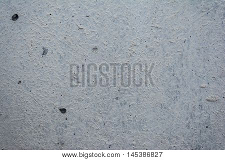 The surface of the concrete wall. Hole scratch. Background texture.