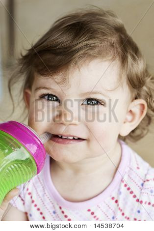 Cute Little Girl Drinking From Cup