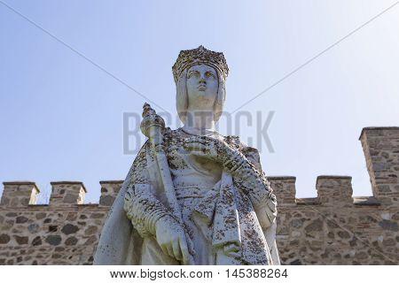 Statue of Queen Isabella I of Castile founder of the monastery San Juan de los Reyes in Toledo. Spain