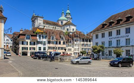 Solothurn, Switzerland - 10 July, 2016: view on Klosterplatz square with towers of the St. Ursus Cathedral in the background. The city of Solothurn is the capital of the Swiss Canton of Solothurn.