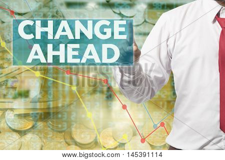 Businessman touching Change Ahead on business background
