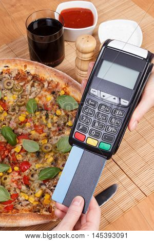 Using Credit Card And Payment Terminal For Paying In Restaurant, Finance Concept, Vegetarian Pizza