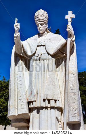 FATIMA, PORTUGAL - MAY 11, 2014 Pope Pius XII Statue Basilica of Lady of Rosary Fatima Portugal. Church created on site where three Portuguese Shepherd children saw Virgin Mary of the Rosary. Basilica created in 1953. Statue erected in 1961.