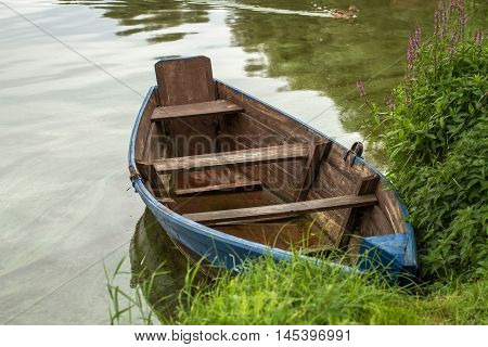 Boat Left The Shore Of The Lake