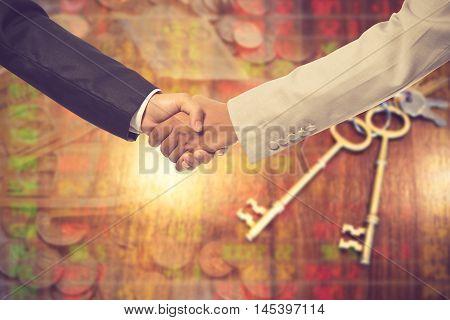 Handshake Of Businessmen On Blur Business Background.vintage Color