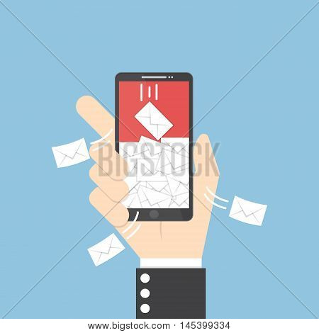 Businessman Hand Holding Smartphone With Spaming Emails On Monitor