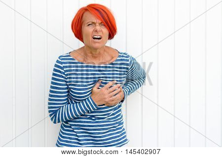 Middle-aged Redhead Woman Suffering A Heart Attack