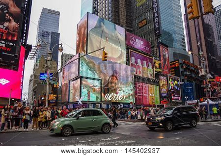 New York city, USA - July 21, 2014: The Times Square at evening in New York Times Square is major commercial intersection in New york and one of the most visited tourist attractions in the world.