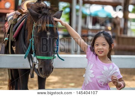 Child With Horse In Farm