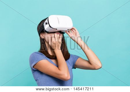 Woman watching though VR device and feeling frighten