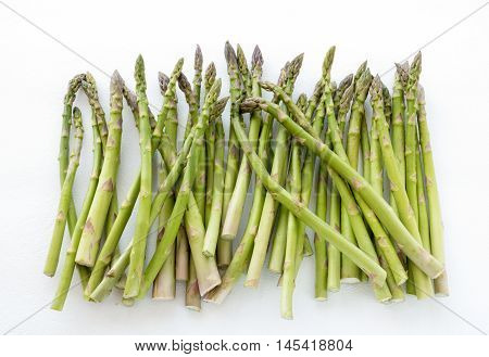Green asparagus spears isolated on white background.